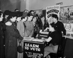 Women surrounded by posters in English and Yiddish supporting Franklin D. Roosevelt, Herbert H. Lehman, and the American Labor Party teach other women how to vote, 1935. (Credit: The Kheel Center for Labor-Management Documentation and Archives. License: CC-BY)