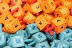 Image: Colorful dreidels2 (Credit: Adiel lo, license: CC-BY-SA 3.0 Unported). Colorful dreidels for sale in Machne Yehuda market, Jerusalem with Israel specific lettering on blue dreidels and diasporah lettering on orange dreidels.