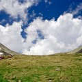 """""""Massive white cloud formation on a blue summer sky, between two mountain peaks. (credit: Maria Varlan, license CC BY)"""