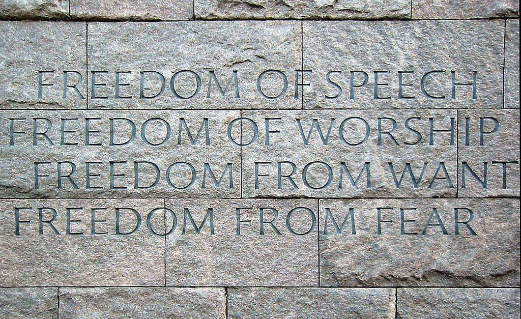 "Photo of a wall with the ""Four Freedoms"" at the Franklin Delano Roosevelt Memorial, Washington DC (credit: BanyanTree, photographer and Hohum, image correction; license, CC-BY-SA)"