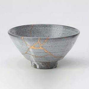"""Tea bowl fixed in the Kintsugi method"" (Public Domain). Kintsugi  is the Japanese art of fixing broken pottery with lacquer resin dusted or mixed with powdered gold, silver, or platinum."