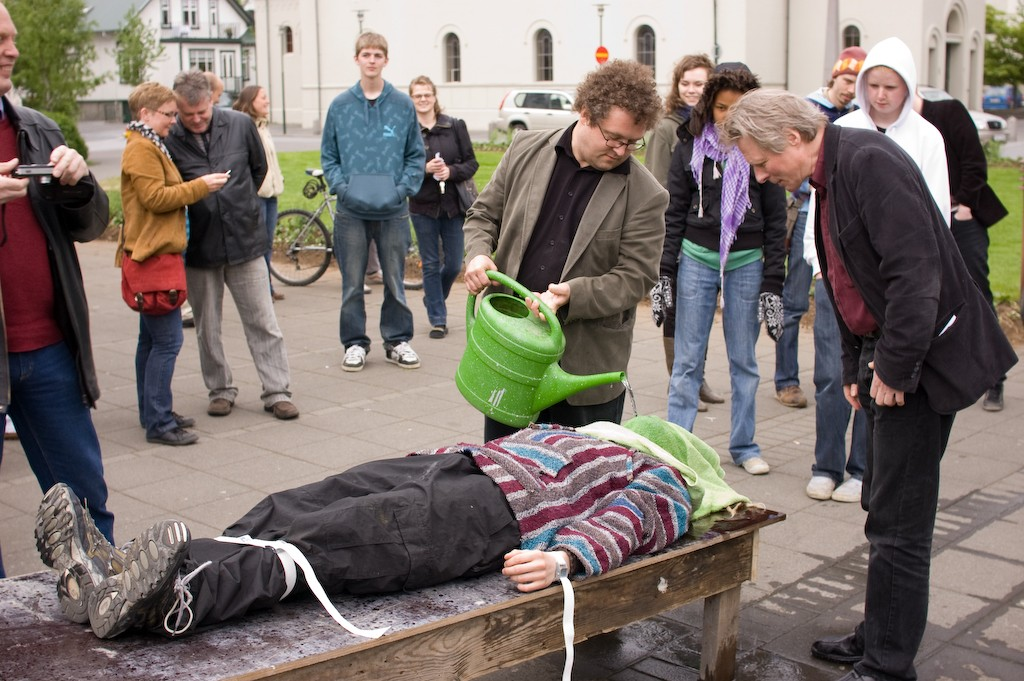 Photo from a protest against waterboarding, on the occasion of Condoleezza Rice's visit to Iceland, by Campaign Against Military Bases. Condoleezza Rice was invited to the protest and to try waterboarding for herself but as she didn't show some volunteers tried it out for themselves. (credit: Karl Gunnarsson, license: CC BY-SA)