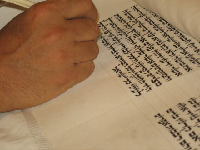 """Sofer writing the last letters of the Torah book in the mitzpeh club."" (credit: Ronia Harari, license: CC BY)"