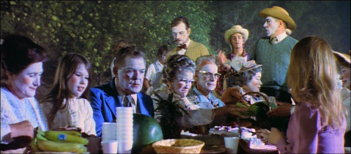 a still frame (01:02:54) of the everyday evening Fourth of July Parade and Picnic in Topeka Downunder from the film adaptation of Harlan Ellison's post-apocalyptic tale: A BOY AND HIS DOG (1975)