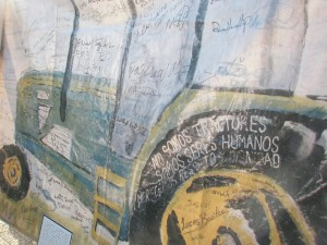 """We Are Not Tractors"" Banner, signed by members of the CIW, 1998. Created in response to an Immokalee tomato grower who said, ""The tractor doesn't tell a farmer how to run a farm."""