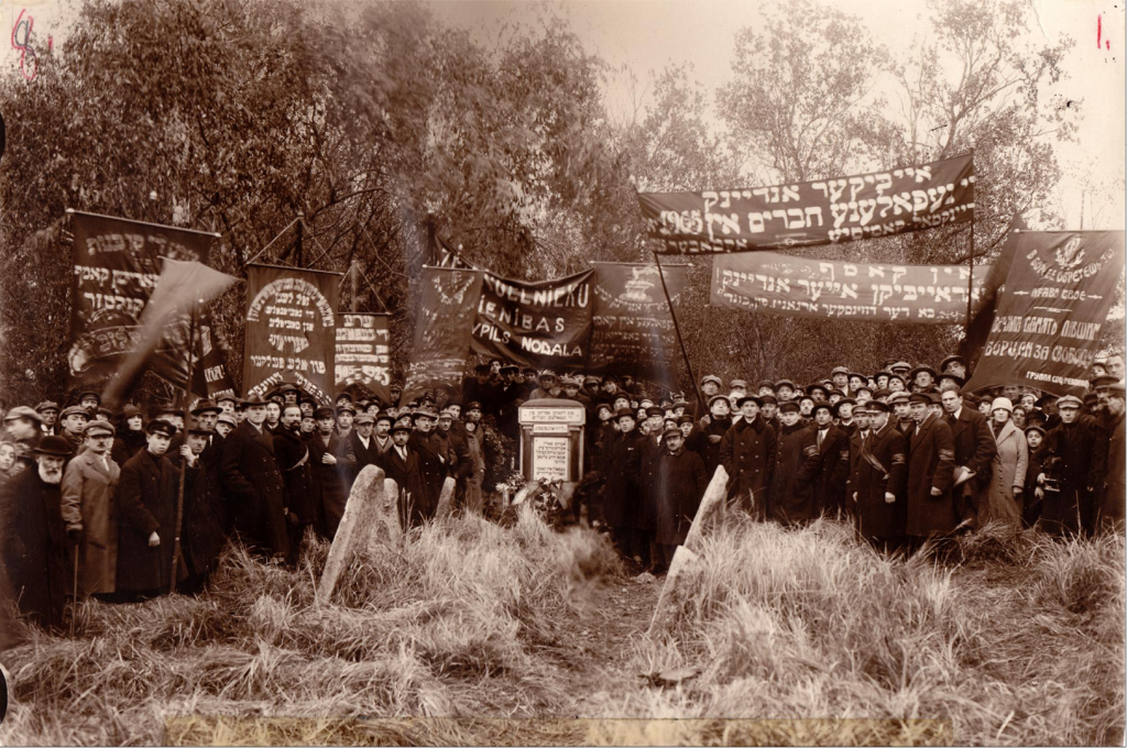 "A ceremony at the Jewish cemetery in honor of an anniversary of the Russian Revolution of 1905, Dvinsk (now Daugavpils, Lat.), ca. 1910. The Yiddish and Russian banners honor ""fallen comrades"" and one Yiddish banner (second from left) reads, in part: ""Long live the national and social liberation of all peoples! (YIVO)"