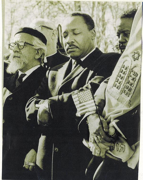 Rabbi A.J. Heschel, Rev. Dr. Martin Luther King, Jr., Rev. Ralph Abernathy, Rabbi Maurice Eisendrath (holding Torah). March for Peace at Arlington National Cemetery on February 6, 1968