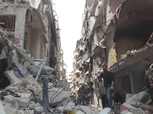 """Damage in Christian quarter of Aelppo in Syria"" (credit: Vatican Insider, license: CC BY-SA)"