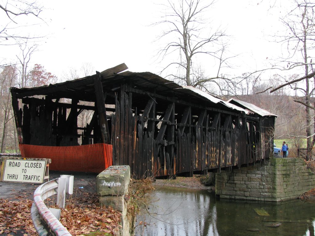 """Gudgeonville Covered Bridge after destruction by arson"" (credit: Amy Matthers, license CC BY-SA)"