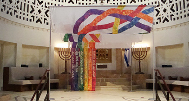 The Rainbow Ḥupah by textile artist Temma Gentles. in Holy Blossom Temple, Toronto (via an article in Canadian Jewish News)