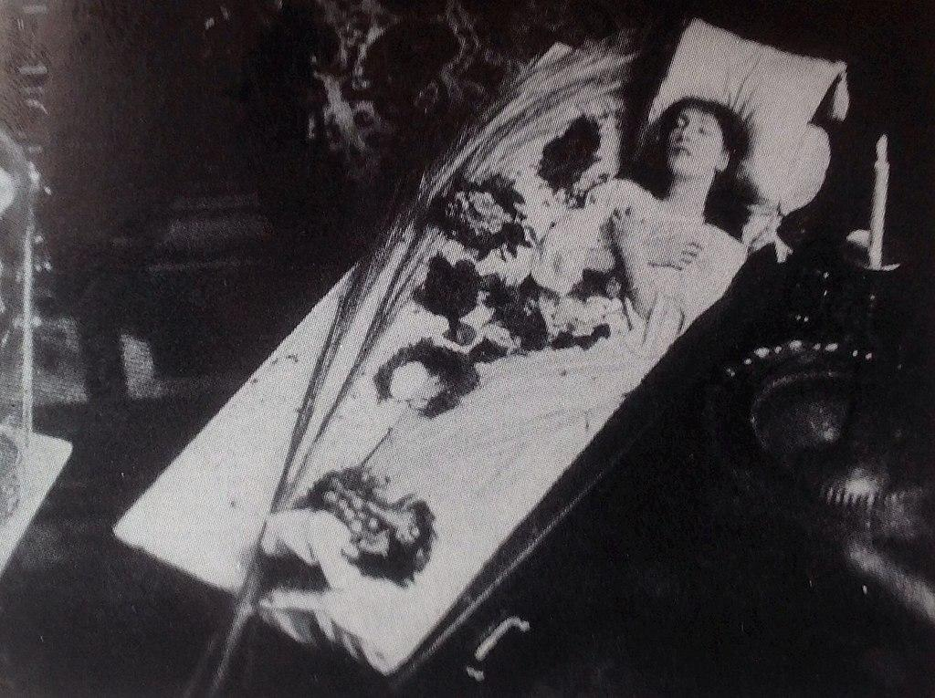 Sarah Bernhardt in the famous coffin in which she sometimes studied roles. Photo about 1873.