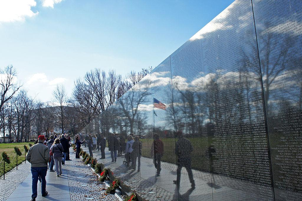 """US flag reflexion on the Vietnam Veterans Memorial Wall, National Mall, Washington, D.C. (credit: Mariordo (Mario Roverto Durán Ortiz), license CC BY-SA, 2011)"