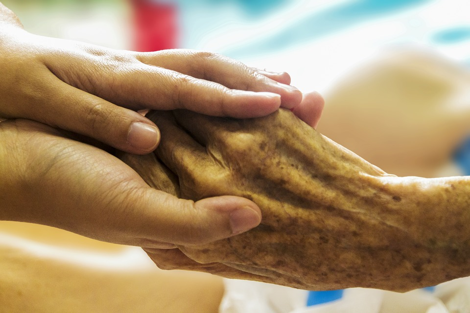 """Hospice hand in hand caring care"" (credit: truthseeker08, license: CC0)"