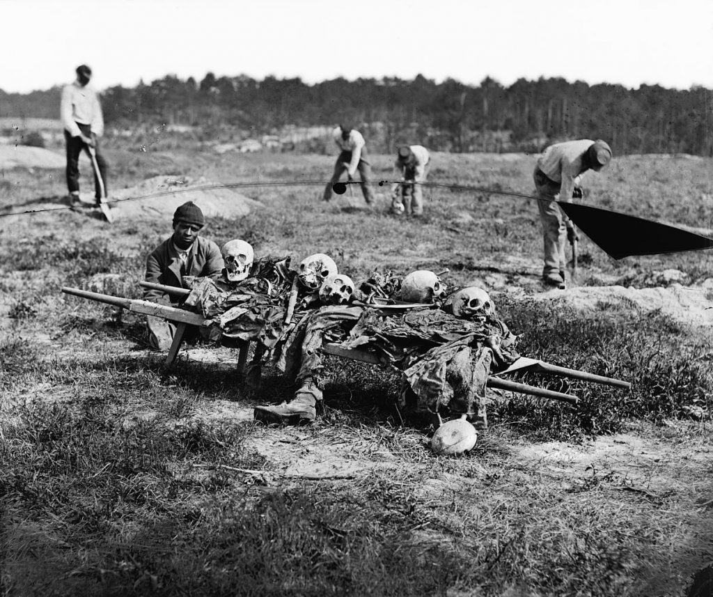 """Cold Harbor, Va. African Americans collecting bones of soldiers killed in the battle. April 1865."" (credit: Reekie, John, photographer, compiled by Hirst D. Milhollen and Donald H. Mugridge; license: PD)"
