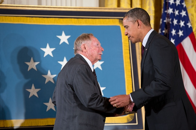 """""""President Barack Obama presents the posthumous Medal of Honor for Sgt. Alfred B. Nietzel, Company H, 2nd Battalion, 16th Infantry Regiment, during the Medal of Honor ceremony in the East Room of the White House, March 18, 2014."""" The award is accepted on his behalf by his cousin Robert Nietzel. (Official White House Photo by Pete Souza)"""