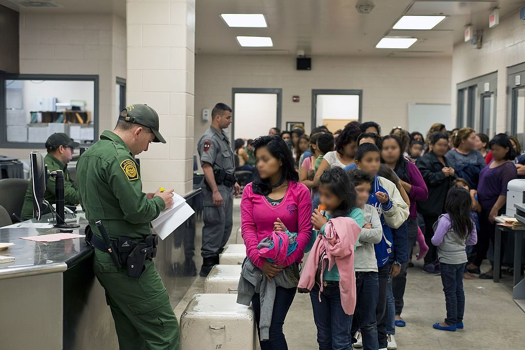 """South Texas Border - U.S. Customs and Border Protection provide assistance to unaccompanied alien children after they have crossed the border into the United States, 2014."" (Photo provided by: Hector Silva, Public Domain)"