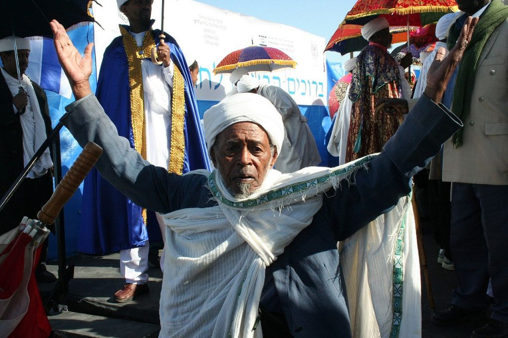 """the Ethiopian Jewish holiday of sigd, reminiscent of Shavuot (credit: האגודה הישראלית למען יהודי אתיופיה, license: CC BY-SA)"