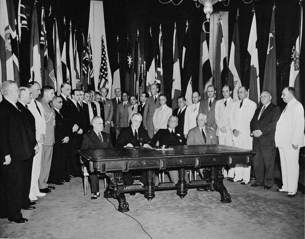 Washington, D.C. Representatives of 26 United Nations at Flag day ceremonies in the White House to reaffirm their pact. Seated, left to right: Dr. Francisco Castillo Najera, Ambassador of Mexico; President Roosevelt; Manuel Quezon, President of the Philippine Islands; and Secretary of State Cordell Hull