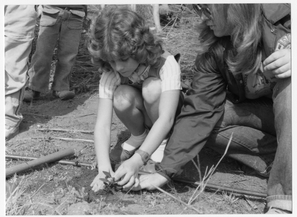 Arbor Day, Wild Animal Park, Girl Scout Plants Tree Assisted by Leader (circa 1979-1986)