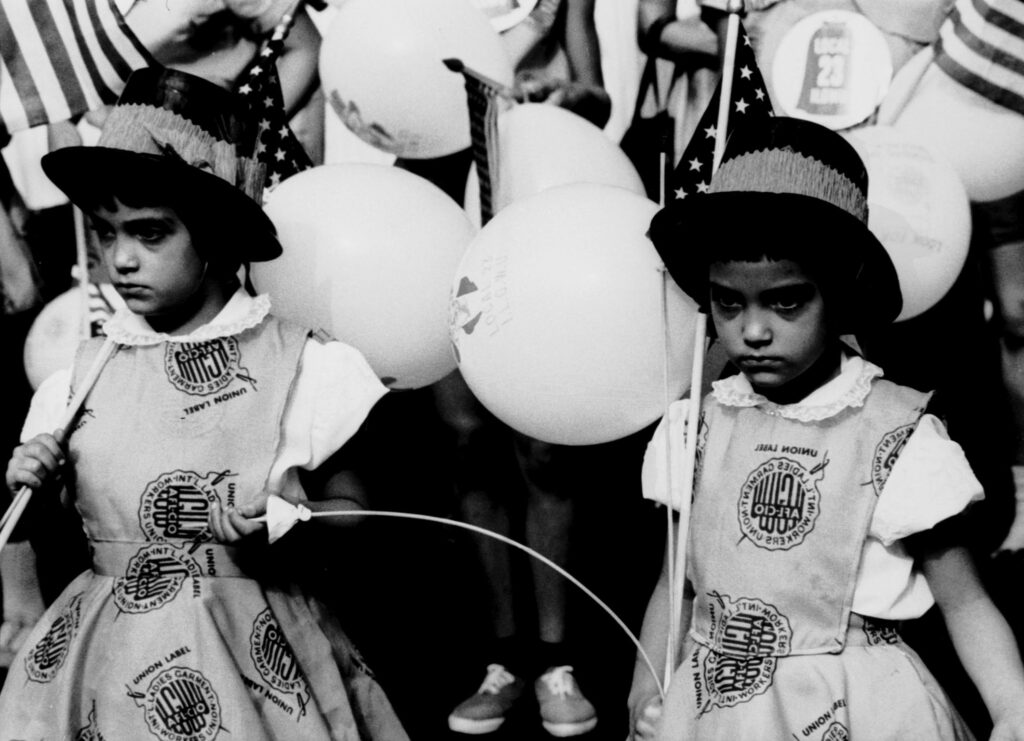 Two girls at the Labor Day parade wearing ILGWU union label dresses (Kheel Center 1960, CC BY)